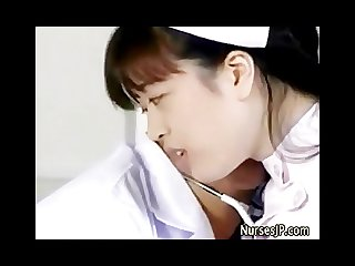Asian doctor and nurse foreplaying