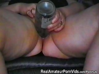 An older couple film themselves playing with wifes pussy