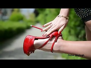 Walking with red hooker high heels