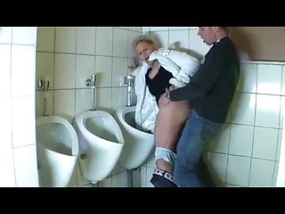 Guy fucks a mature in a public bathroom