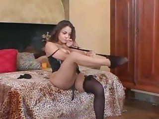 Busty milf teases in stockings a bra and heels