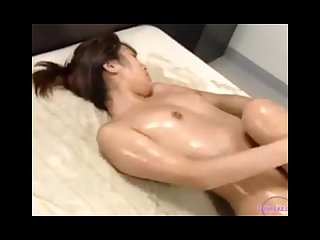 2 asian girls with oil on body licking rubbing pussies in scissor on the be