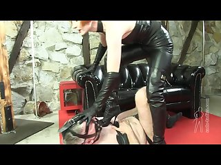 Leather mistress torturing slave