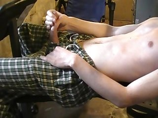 Shaved man masturbating after work out