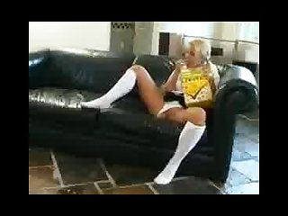 Pissing schoolgirl on a couch part 1