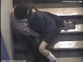 Voyeur sex inside of building stair