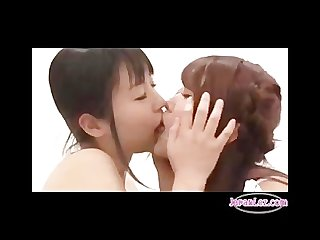 Asian lesbians rubbing bodies and french kissing