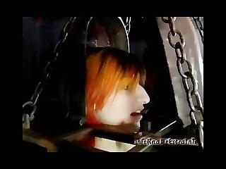 Caged redheaded slut