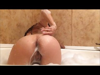 Fucking my pussy in the bathtub