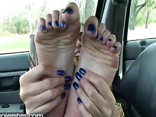 Sexy foottease in car