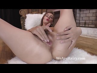 Melody strips and masturbates on her white rug