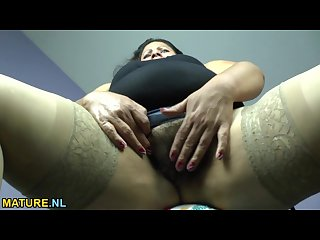 Fat latina mature undressing and spreading legs