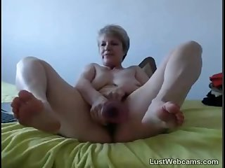 Blonde granny masturbates with dildo on webcam