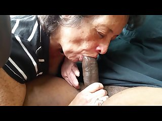 Granny sucking black cock on car