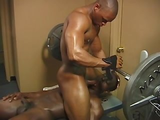 Two black men making love in the gym