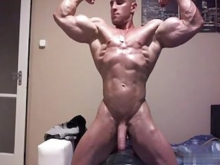 Military bodybuilder flexing with jo