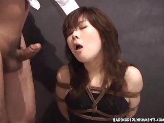 Japanese women gives blowjob whilst tied up in rope