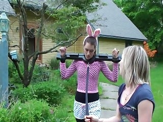 Bondage bunny goes for a walk outside