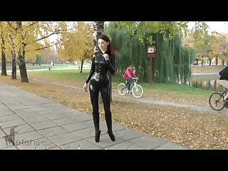 Sexy redhead in latex catsuit and balletboots walking in public