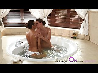 Strapon two beautiful lesbians making love with strapon dildo
