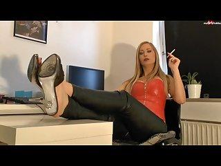 German blonde smoking domina in leather