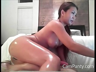 Asian in high heels plays with herself on couch