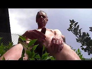 sensational danger huge cumshot and huge piss outdoor in public garden during the passage of people