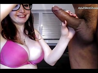 Playful redhead sucks on a black cock - AdultWebShows.com