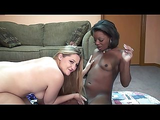 Gorgeous interracial lesbians with strapon fucking each other