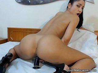 Skinny brunette toys her pussy on cam
