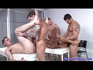 Muscular gay assfucking orgy closeup