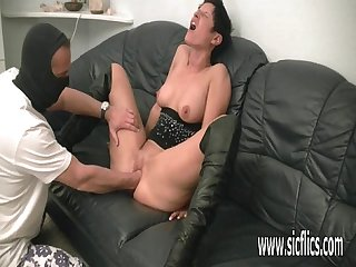 Hot brunette milf fisted by a masked brute