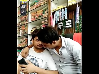 Indian sexy gay couple kissing in shop