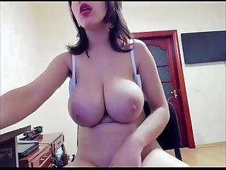 Young girl with huge and natural tits sucking her milk and masturbating with dildo