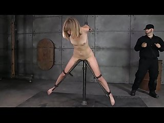Slender blonde in device bondage