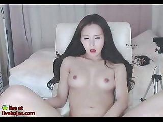 Horny Korean teases with her sexy body
