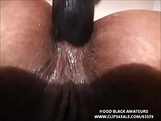 Thick black women has xxx fun with two large dildos comma takes 1 in her asshole