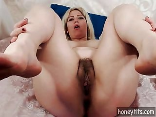 blonde milf with natural big tits and big ass strokes her hairy pussy on cam for..
