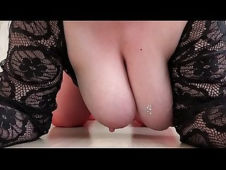 Mature milf in red stockings jumps on a big dildo close up of a big butt
