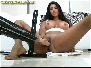 Webcam girl orgasming on a dildo machine