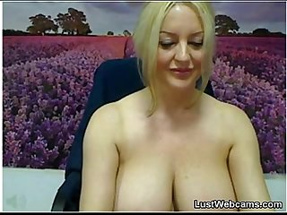 Busty milf plays with her huge tits on webcam
