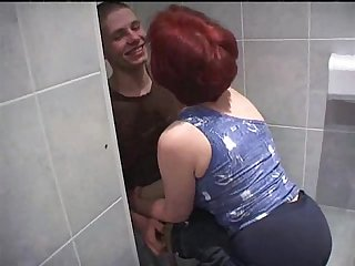 Mature women fuck much younger boy in bathroom