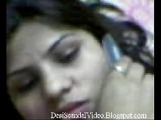 Sexy Desi girl talking in the phone desiscandalvideo blogspot com