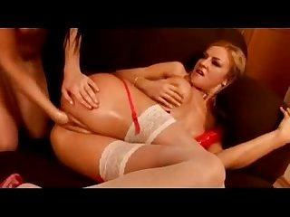 Blonde Girl In Sexy Lingerie Sucking Huge Dildo Getting Her Pussy Fisted By Her Gf On The Couch