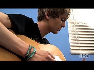 Liam tunes his guitar cock