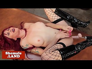 Redhead tgirl tugged and fucked by machine