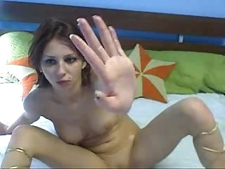 Hot Russian webcam girl fists, licks pussy juice, and gags on fingers!