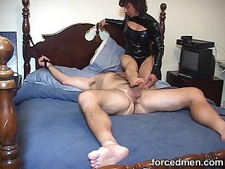 Mistress hardens horny man S cock just by teasing it through the end