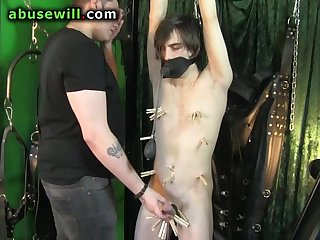 Young slave chained up and punished