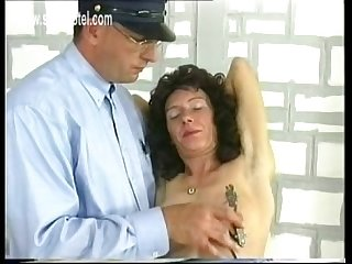 Slave with nice tits and tight ass sitting in a jail got large metal clamps on her nipples